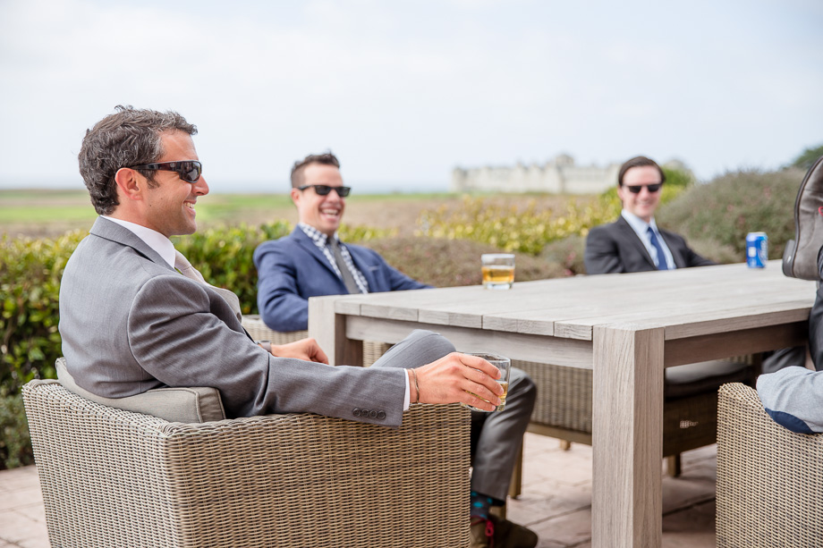 groom and boys drinking/chilling before ceremony - half moon bay wedding photographer