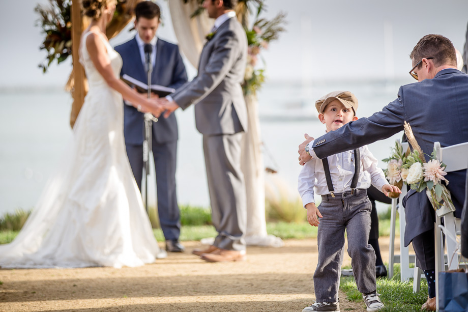 kids will be kids - funny photo of the ring bearer not paying attention during the wedding ceremony