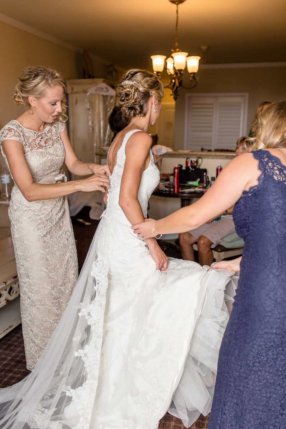 Bride getting into her dress at the Oceano Hotel and Spa