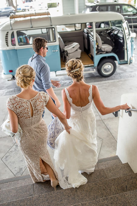 bride and her sister getting ready for wedding ceremony