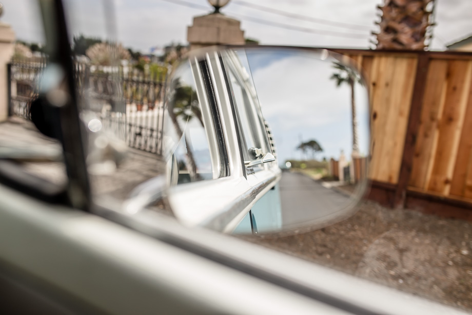 looking back in the rear view mirror from VW bus