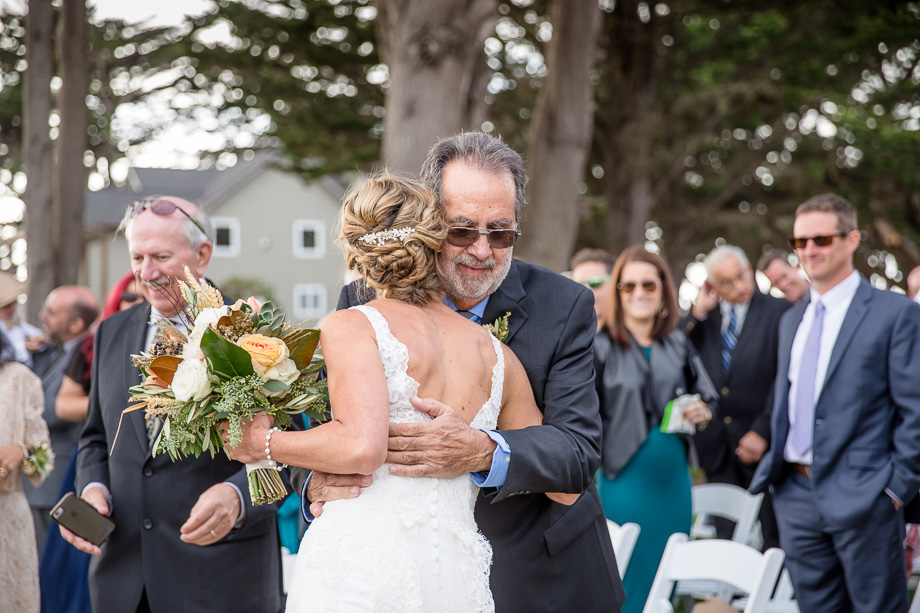 bride and father hugging before the ceremony