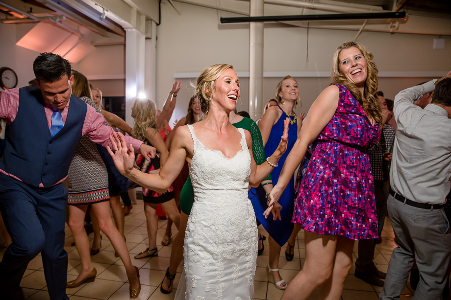 Mavericks Event Center wedding reception party - bride dancing with the guests