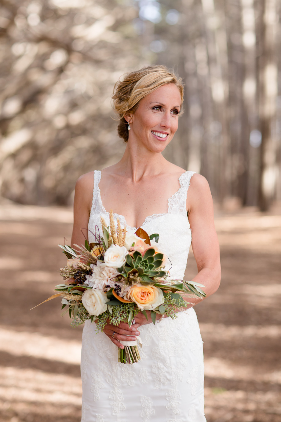 gorgeous bride with an elegant lace wedding gown and a succulent bouquet in a magical forest - Half Moon Bay wedding photographer