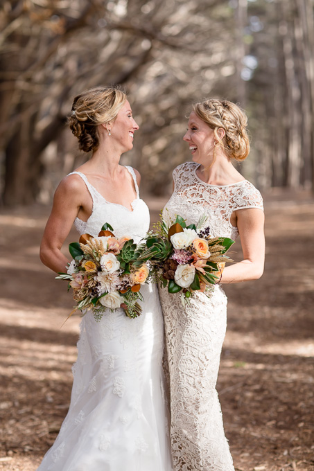 cute photo of bride and maid of honor with their bouquets - San Francisco wedding photographer
