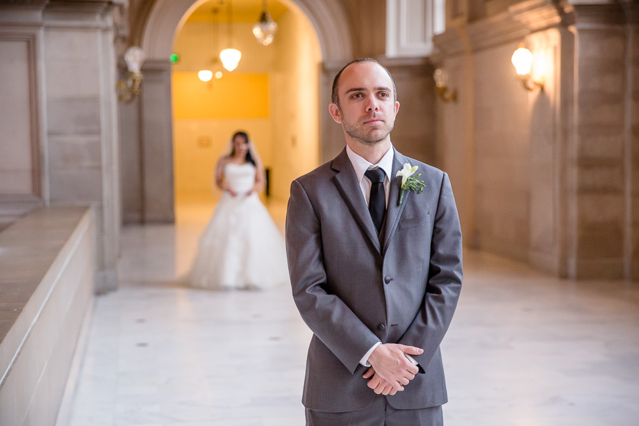 romantic first look at SF city hall before their wedding ceremony and reception