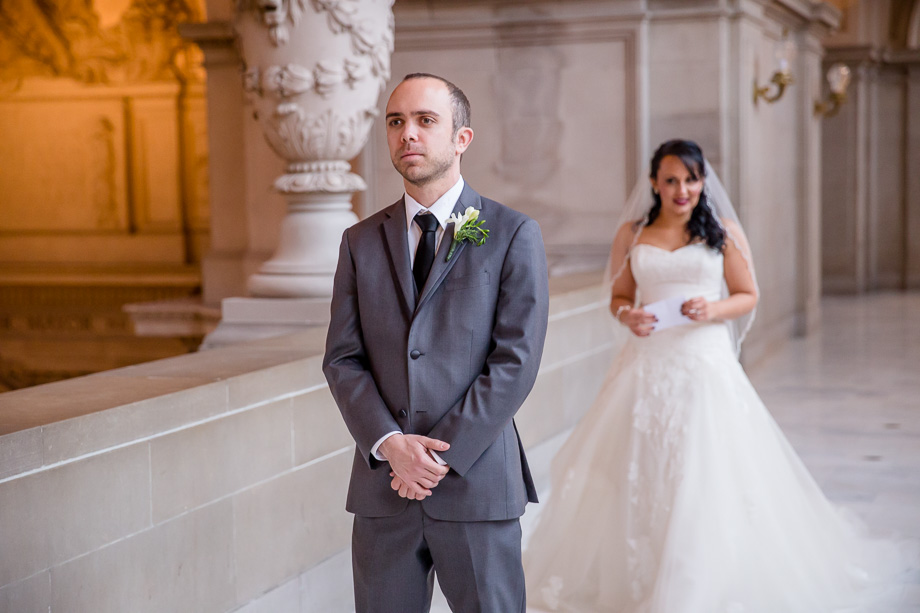 bride approaching her groom for their first look at SF city hall