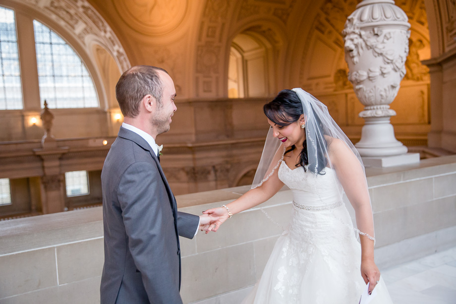 bride and groom sees each other before their wedding ceremony and reception at SF city hall building