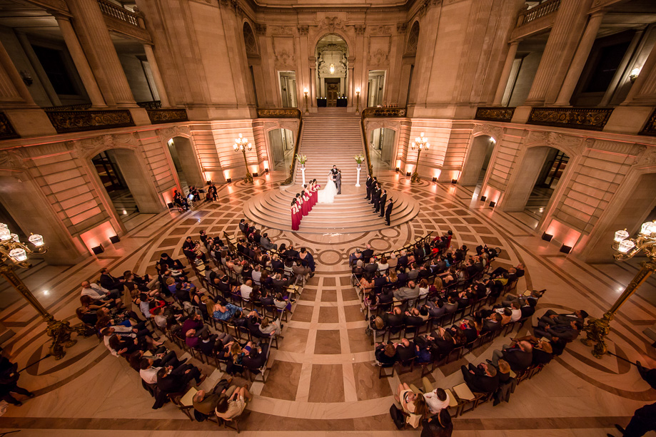 wedding ceremony at the grand staircase at San Francisco City Hall