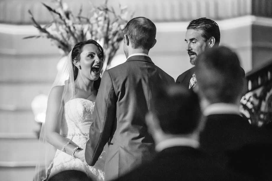 cute moment before being announced as husband and wife - Bay Area wedding photographer