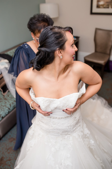 bride putting on her dress at the WorldMark