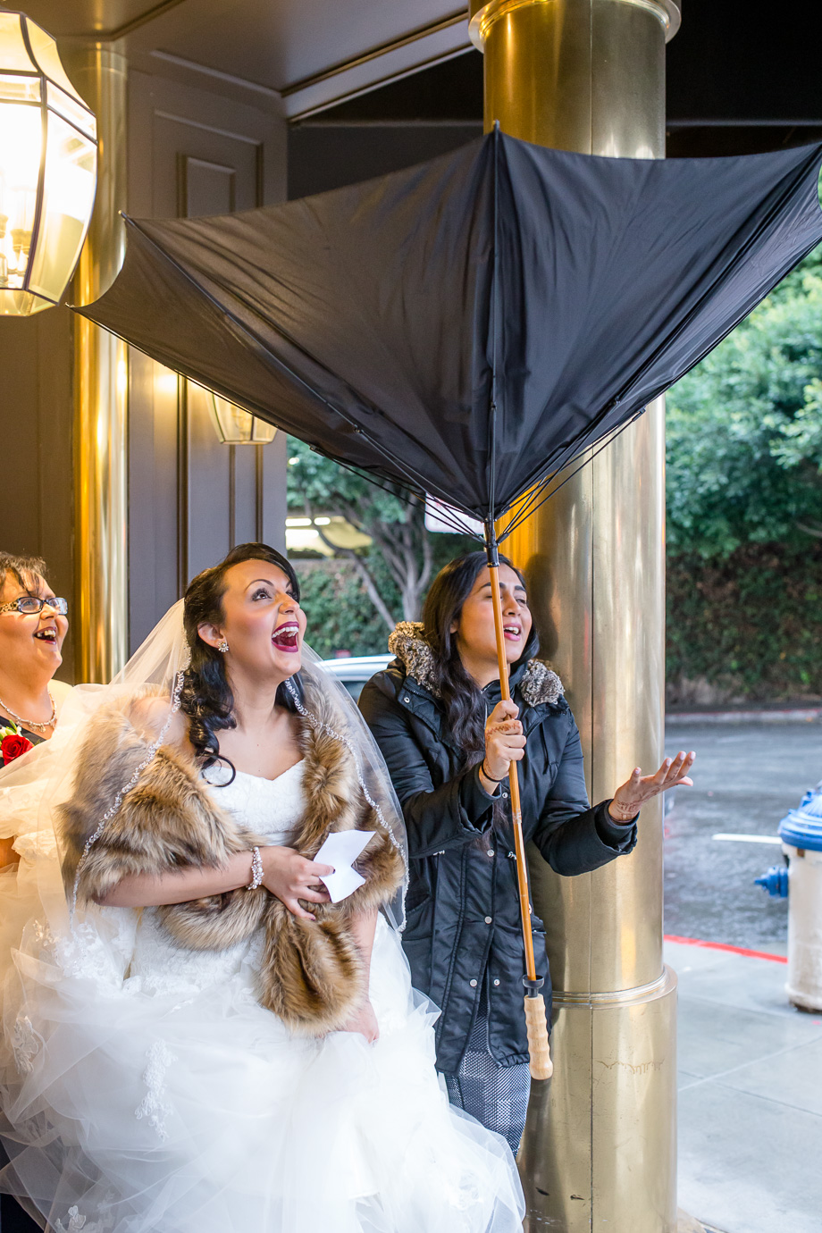 The umbrella flipped upside down when the bride stepped out the hotel lobby for her SF City hall wedding