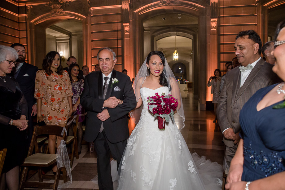bride escorted by father at the City Hall