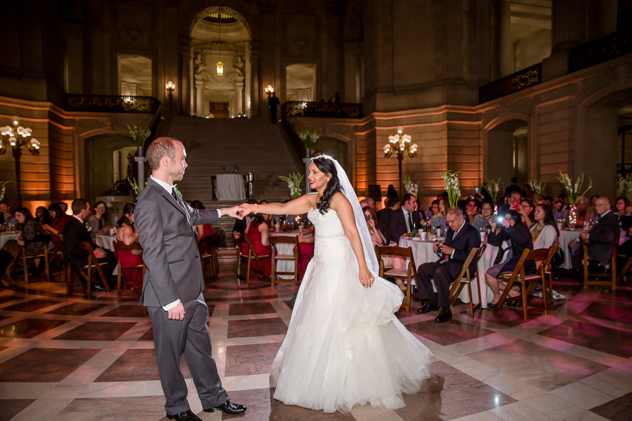 bride and groom dance for the first time as husband and wife at their San Francisco city hall wedding