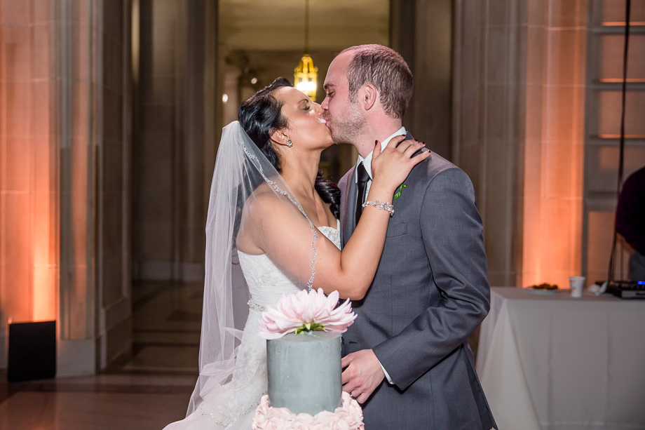 sweet kiss after the cake cutting