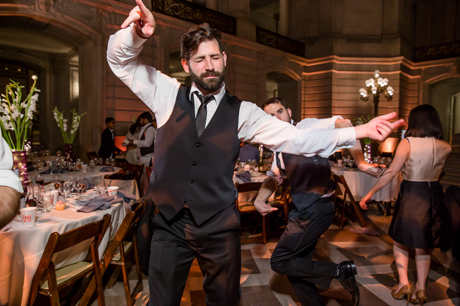 wedding guest dancing at SF city hall reception