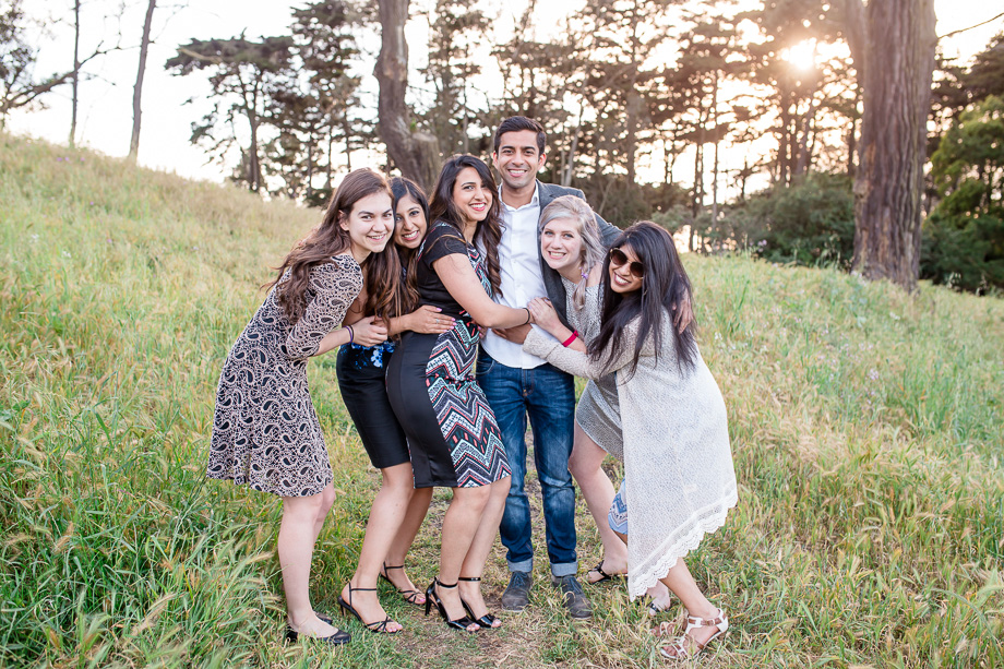 newly engaged couple with their friends at the Presidio