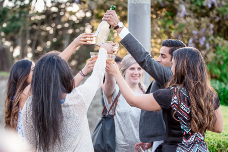 celebrating engagement with champagne