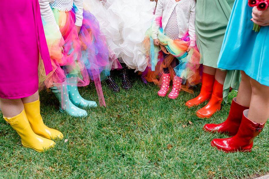 colorful bridesmaid dresses and rain boots for rainbow themed wedding