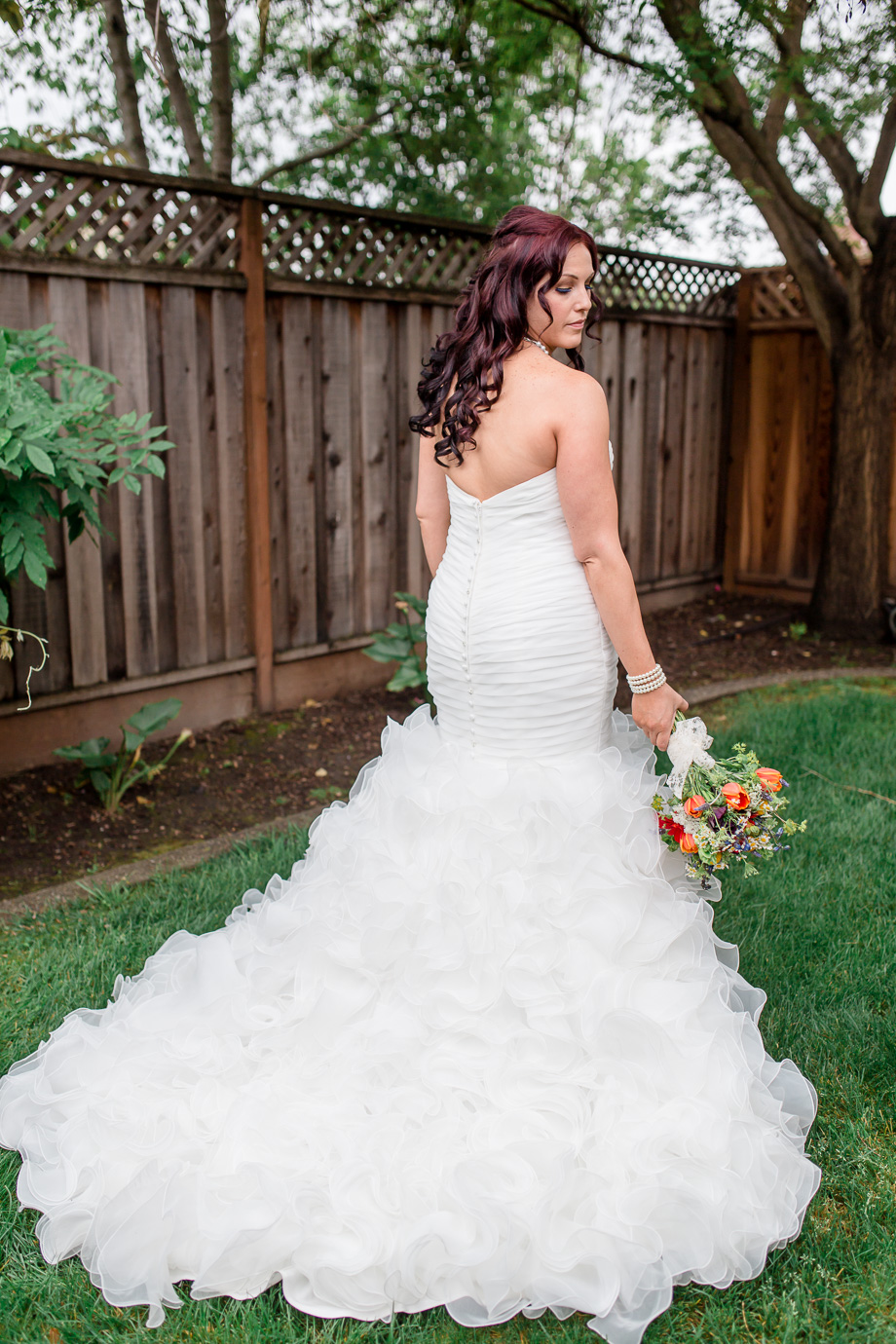 stunning bride with a beautiful ruffled wedding dress - California rainbow themed wedding