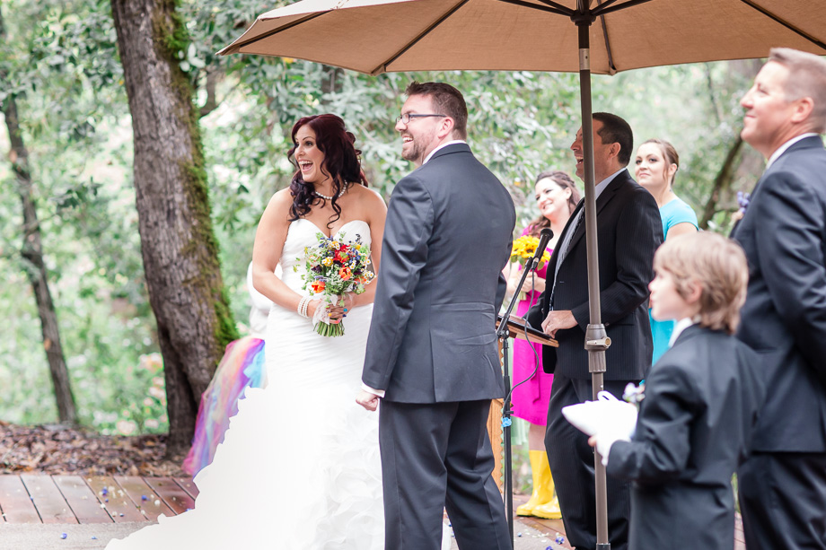 a happy moment during the wedding ceremony in the woods