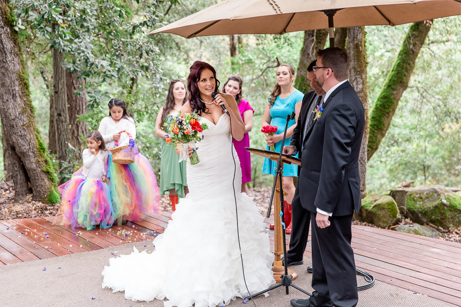 bride giving her vows under an umbrella