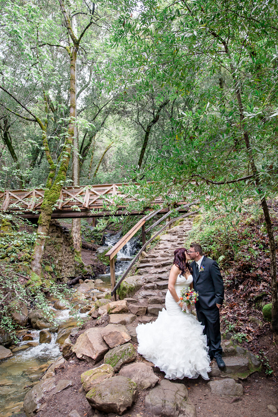 bride and groom wedding portrait by the waterfall in the woods at California Uvas Canyon County Park