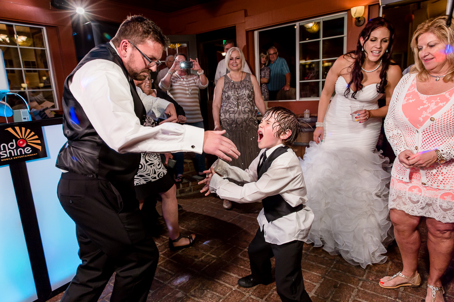 groom and son dancing at Mama Mias Restaurant