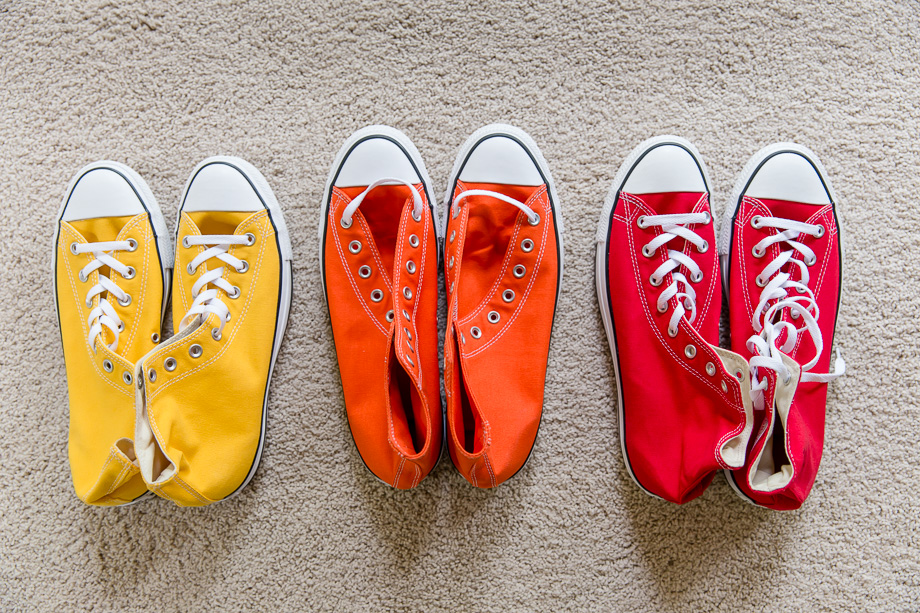 colorful converses for rainbow themed wedding