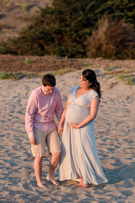 fun and candid maternity photo on the beach
