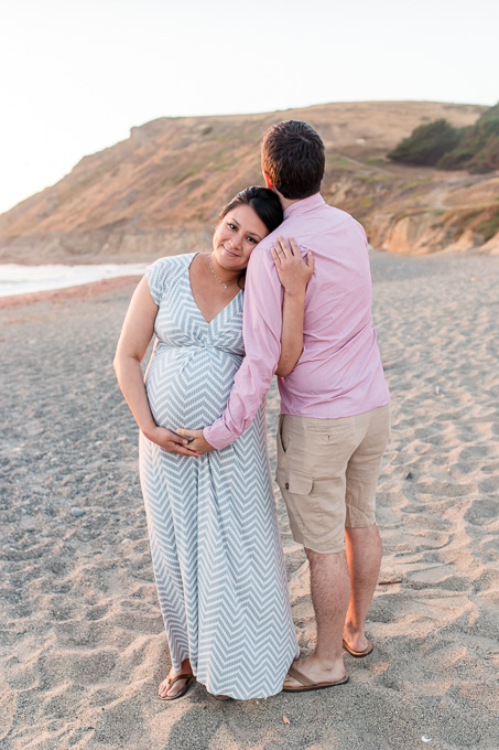 sunset maternity-family photo on the beach facing pacific ocean