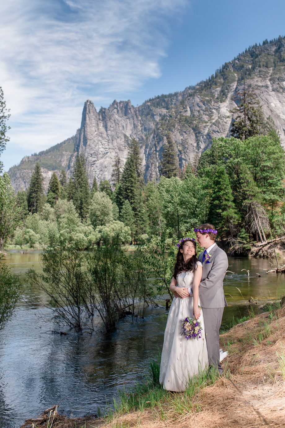 wedding at Merced River in Yosemite looking up at Cathedral Point