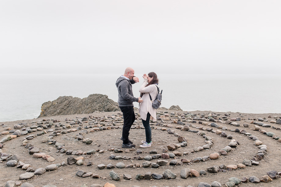 both wiping their tears after they got engaged on a foggy day in san francisco