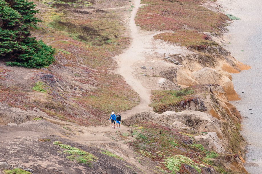 couple walking along the hiking trail by pacifica state beach