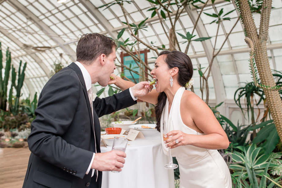 bride and groom feeding each other nachos instead of a traditional wedding cake