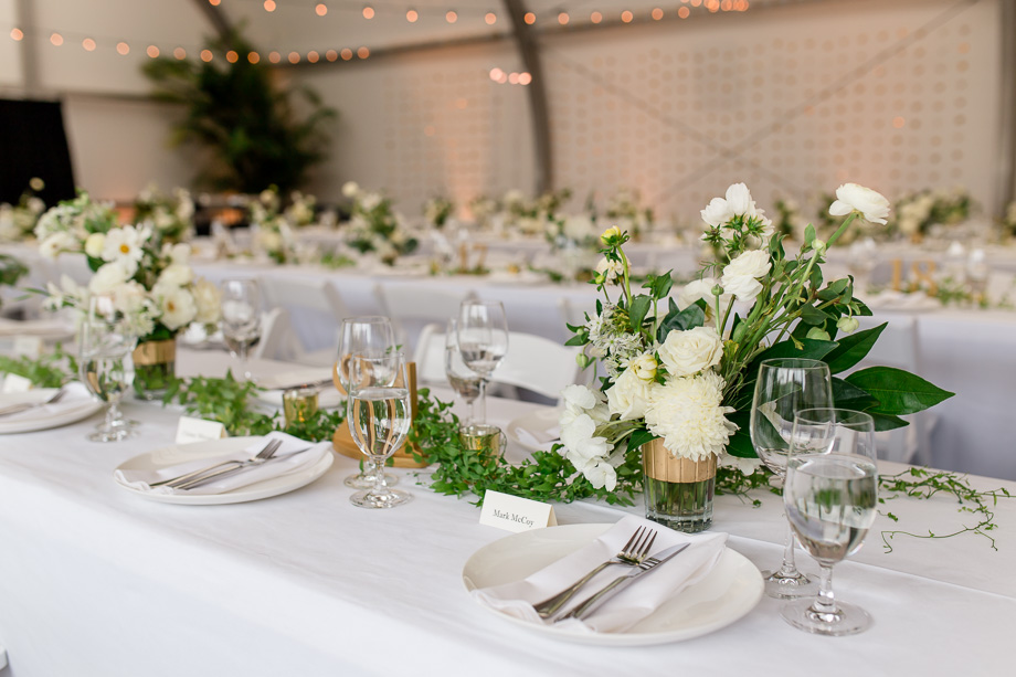 the conservatory of flowers is transformed into this elegant and romantic reception hall with these beautiful centerpieces