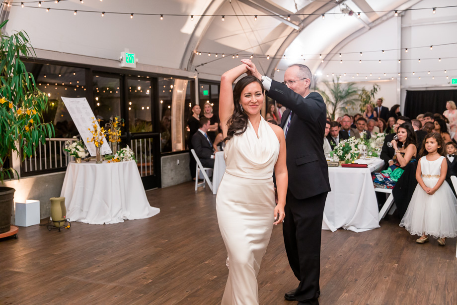bride dancing with her proud dad