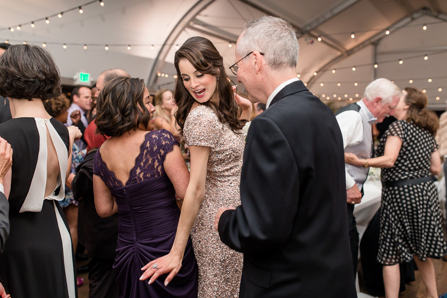 a cute photo of bridesmaid dancing with brides parents