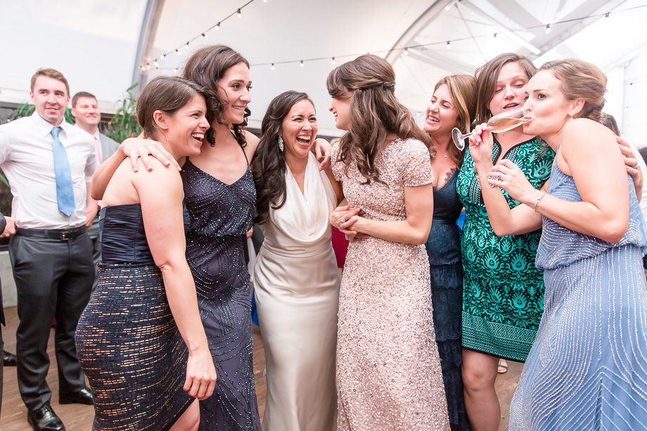 bride with her besties on the dance floor