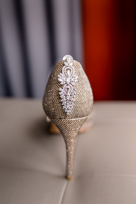 elegant bridal shoes with sparkly earrings
