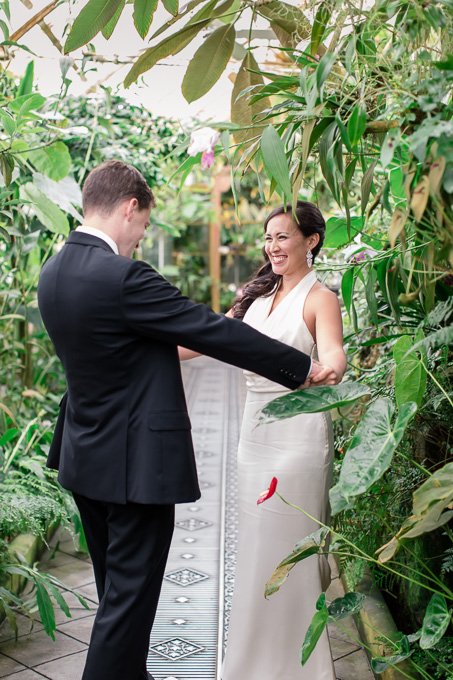 bride and groom first look inside the greenhouse at conservatory of flowers