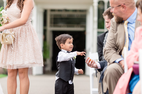 ring bearer handing out golden paper crane at the ceremony