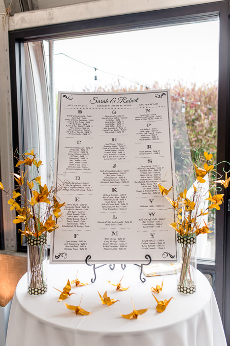 guest seating chart with golden paper cranes