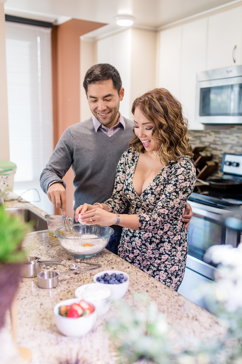 cooking together in their San Francisco downtown apartment for engagement photos is super fun and intimate