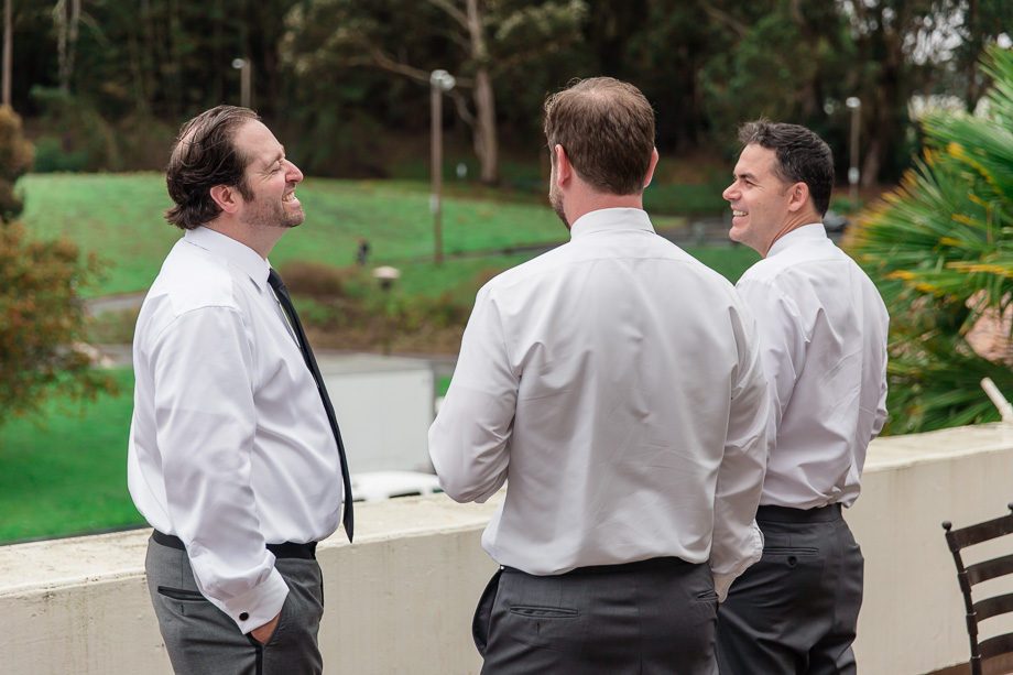 groom and groomsmen relaxing on the balcony