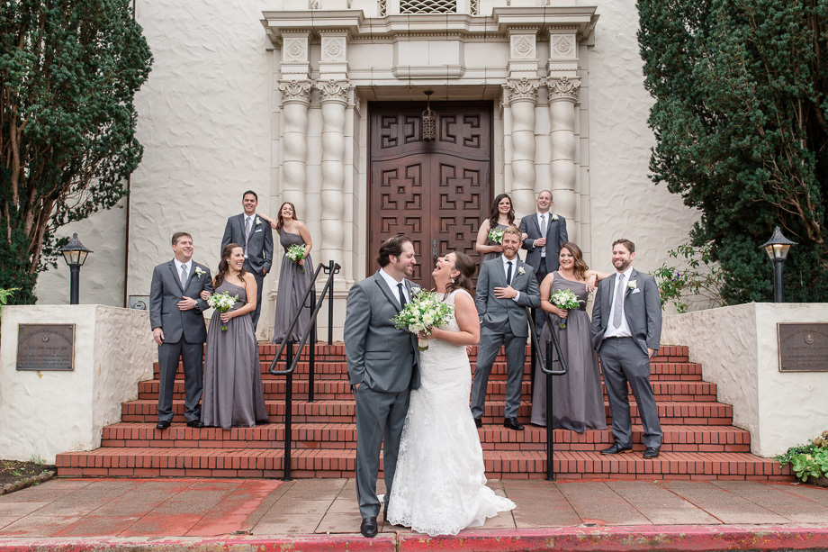 a cute wedding party photo outside the Presidio Church that makes you smile