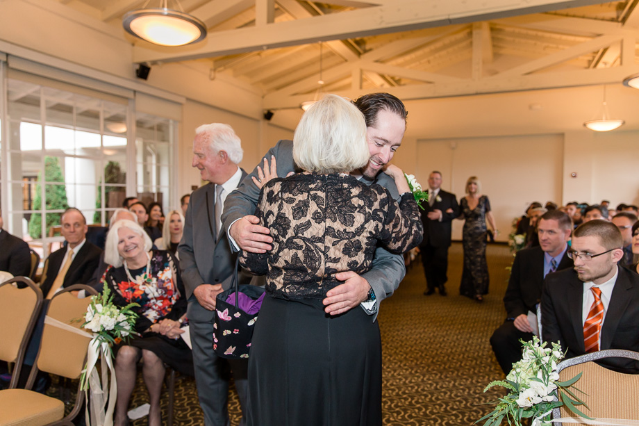 groom hugging his parents
