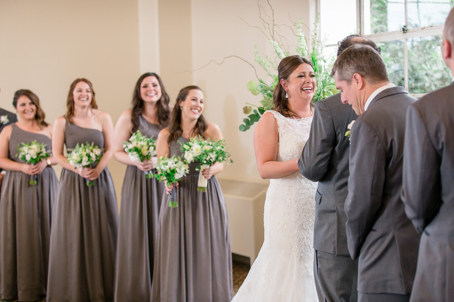 bride laughing at grooms funny vows