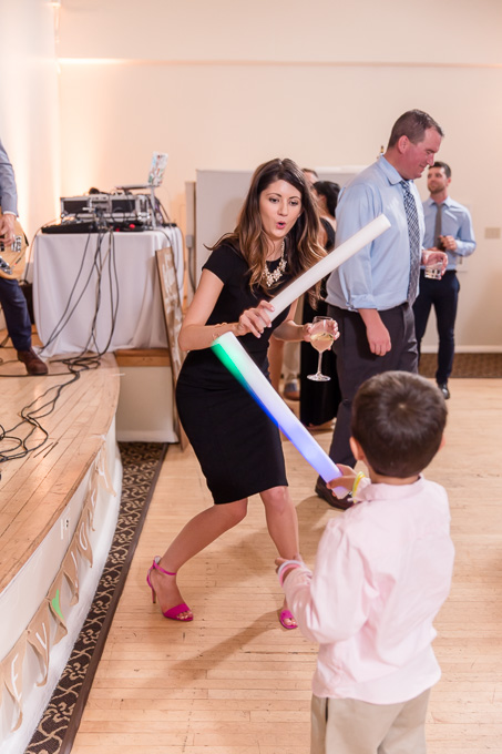 wedding guests having fun with their light sabers