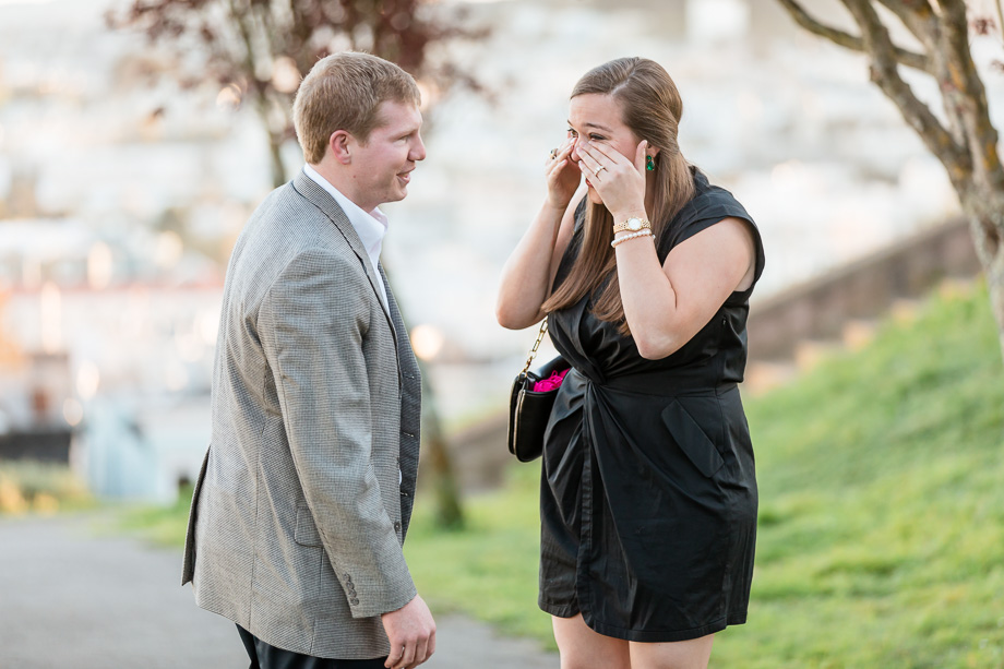 wiping tears of joy from her eyes after proposal